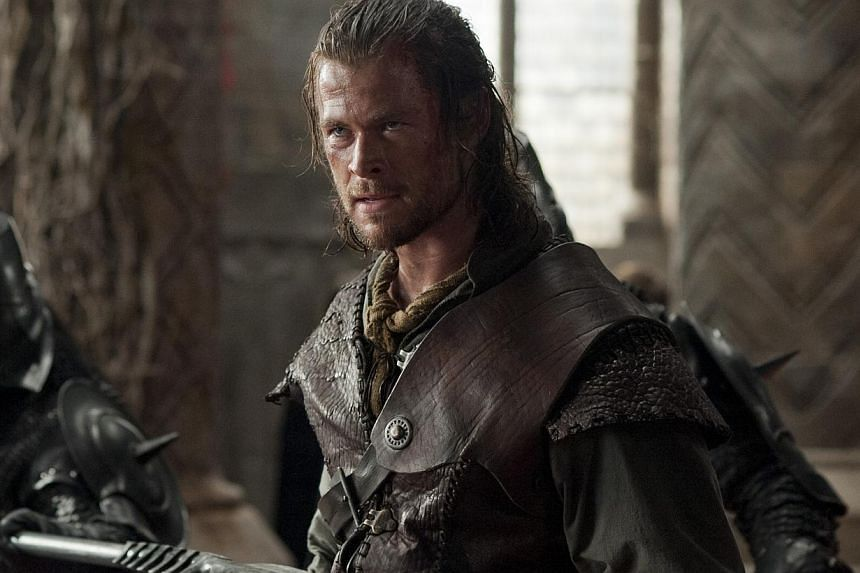 A cinema still from Snow White And The Huntsman starring Chris Hemsworth. Hemsworth has been named People's Sexiest Man Alive. -- PHOTO: UIP