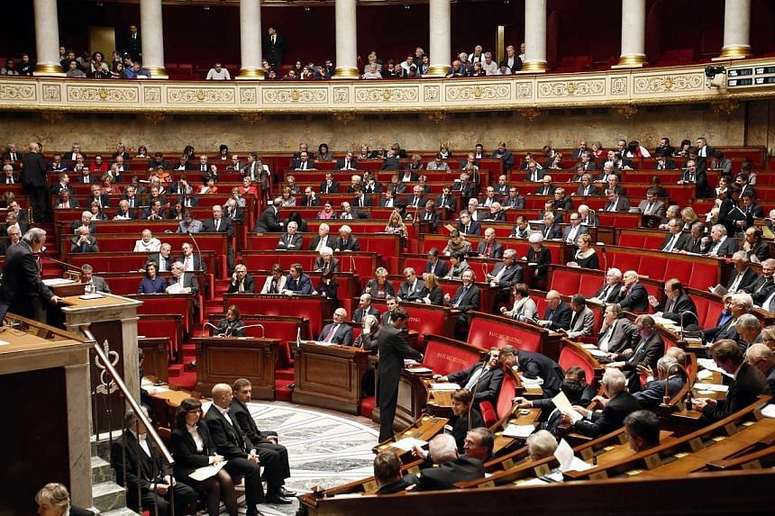 French lawmakers now have the power to launch a US-style impeachment of their president under a new law passed on Wednesday. -- PHOTO: REUTERS