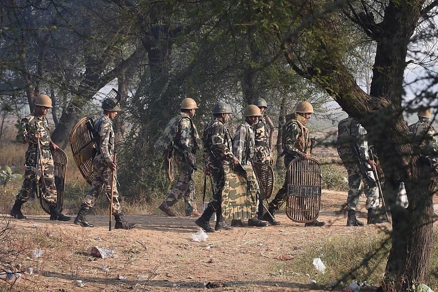 Indian police personnel arrive near the ashram of self-styled 'godman' Rampal Maharaj in Hisar, some 175km north of New Delhi on Nov 19, 2014.Police discovered five bodies on Wednesday after storming the ashram of a wanted guru in norther