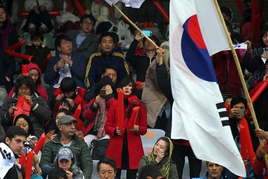 South Korean fans watch an friendly football match between Iran and South Korea at the Azadi stadium in Teheran on Nov 18, 2014.Iran's controversial 1-0 win ended with players, coaches and officials having to be pulled apart by cooler heads, wi