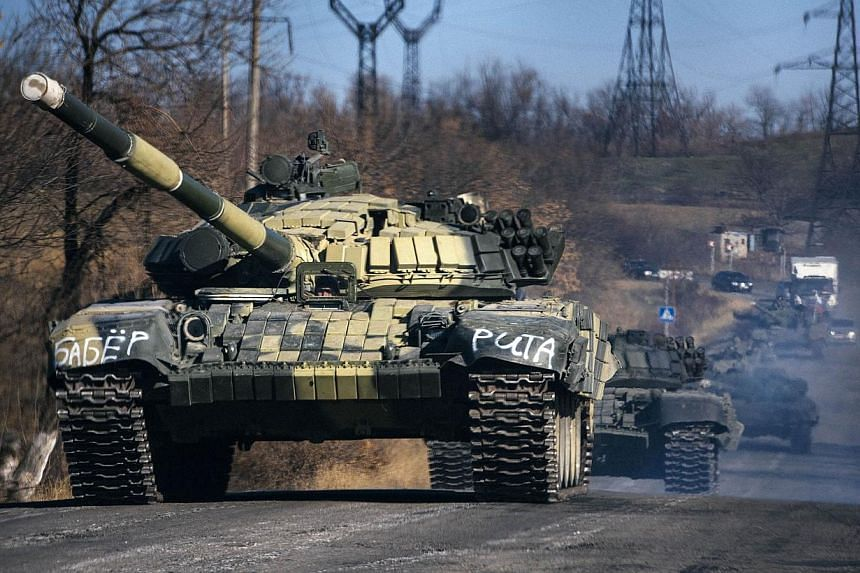 "A column of pro-Russian separatists tanks rides near the town of Krasnyi Luch in Lugansk region, eastern Ukraine, on Oct 28, 2014. Britain's embassy in Kiev risked provoking fresh Russian ire Wednesday by posting a diagram on Twitter ""to help th"