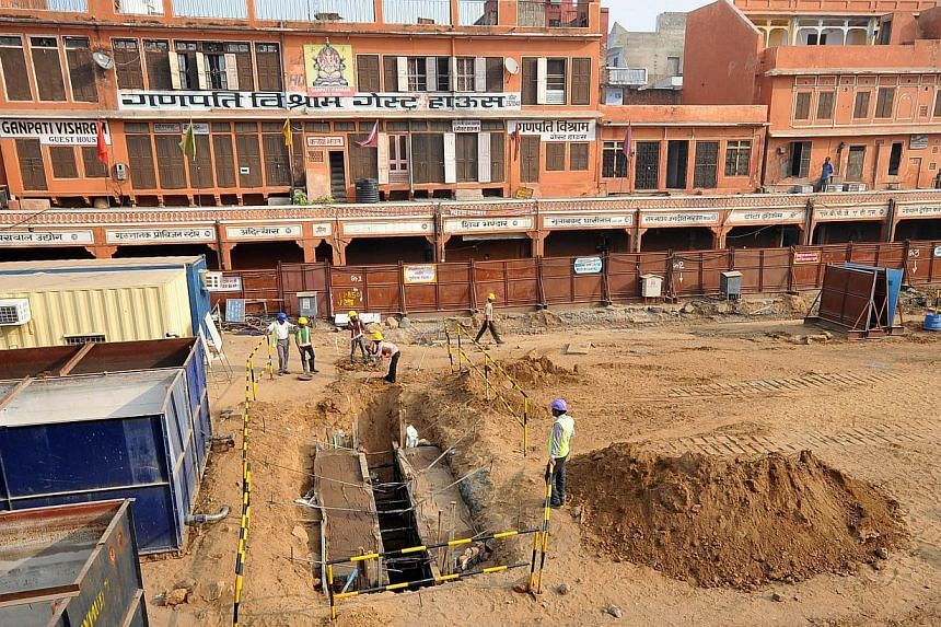 Construction workers at a Metro Rail site on Nov 14, 2014, in the old city area between Chhoti Chaupad and Chandpole in Jaipur. -- PHOTO: AFP