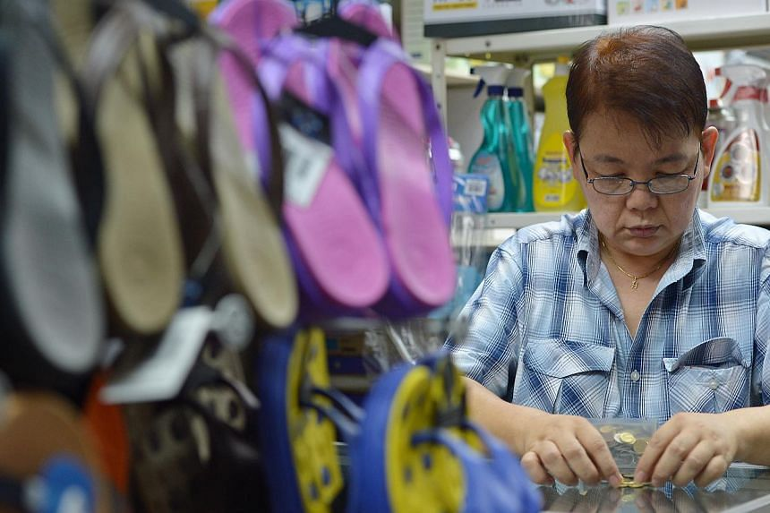 Madam Koh Hong Cheng of Tung Kuang Trading and Refrigerator Service says she never rejects coins. While heartland firms welcome coin payments, five-cent coins are out as customers are unwilling to take them as change.