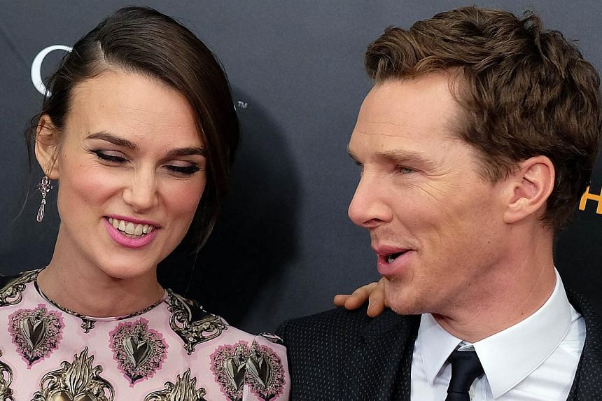"British actors Keira Knightley (left) and Benedict Cumberbatch arrive for the US premiere of ""The Imitation Game"" at the Ziegfeld Theatre in New York on Nov 17, 2014. -- PHOTO: AFP"