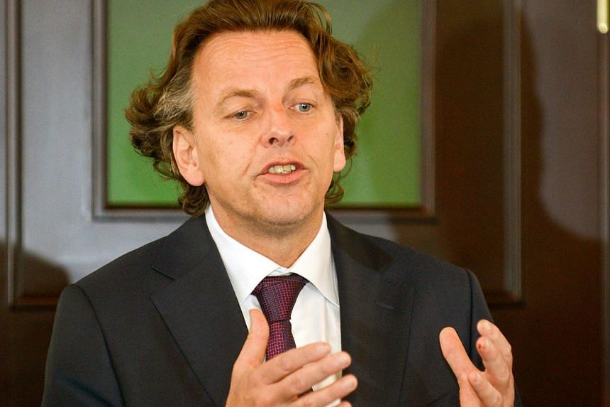 Ukrainian security services claimed on Tuesday to have thwarted a plot against Dutch Foreign Minister Bert Koenders (above) as he paid his respects to the victims of downed Malaysia Airlines flight MH17 on Nov 8, 2014. -- PHOTO: AFP