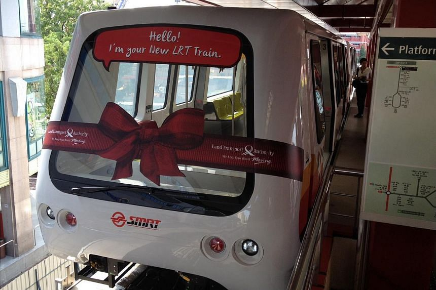 The first two of 13 new train cars that were added to the Bukit Panjang LRT system on Wednesday. The additional cars will help to improve capacity and train frequencies along the network. -- ST PHOTO: ADRIAN LIM