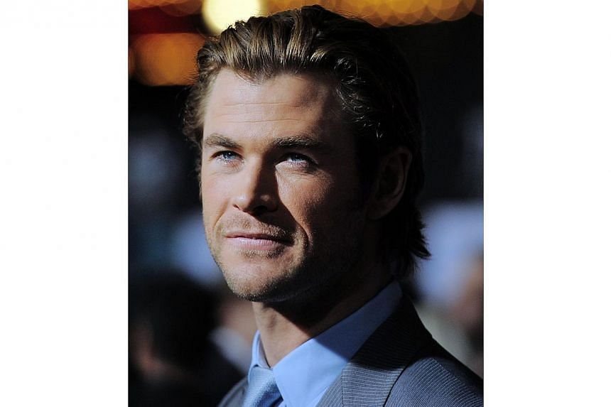 Australian actor Chris Hemsworth at the premiere of Marvel's Thor: The Dark World at the El Capitan Theatre in Hollywood, California, on Nov 4, 2013. Hemsworth has been named People's Sexiest Man Alive, ahead of challengers Chris Pratt and Matthew