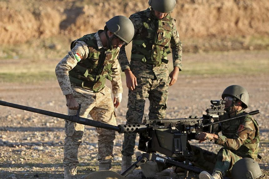 Kurdish peshmerga fighters undergo training by British soldiers at a shooting range in Arbil, in Iraq's northern autonomous Kurdistan region. The president of Iraqi Kurdistan accused Western countries on Wednesday of not providing enough heavy weapon