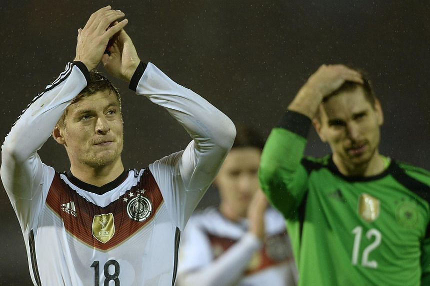 Germany's midfielder Toni Kroos celebrates at the end of the friendly football match Spain vs Germany at the Balaidos stadium in Vigo on Nov 18, 2014. -- PHOTO: AFP