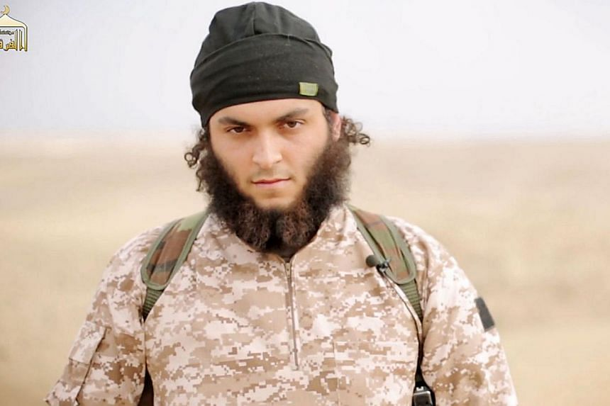 An image grab taken from a propaganda video released on Nov 16, 2014 by al-Furqan Media allegedly shows Mickael Dos Santos, a jihadist believed to be French citizen and member of the Islamic State in Iraq and Syria (ISIS) jihadist group, who also goe
