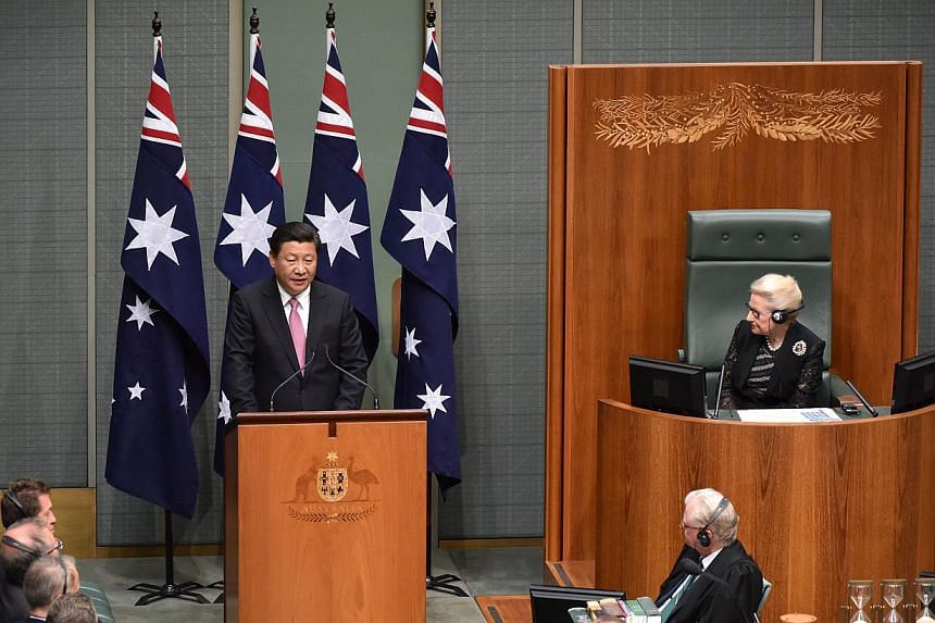 China's President Xi Jinping addressing the Australian Parliament during his visit to Canberra on Nov 17, 2014. Mr Xi is visited Canberra after attending the G-20 Summit in Brisbane over the weekend. -- PHOTO: AFP