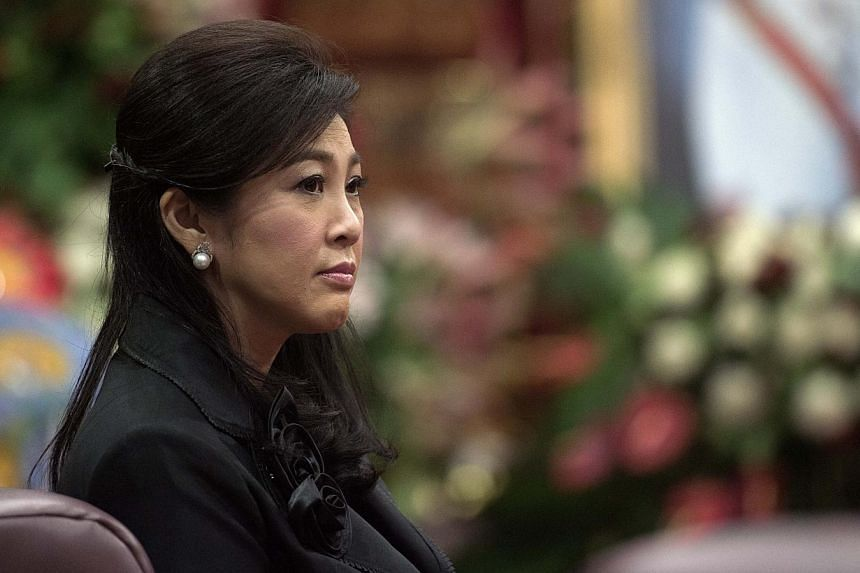 Ousted Thai prime minister Yingluck Shinawatra at a funeral ceremony inside a Buddhist temple in Bangkokon Sept 29, 2014. The move to get Ms Yingluck to stand trial in the Supreme Court's Criminal Division for Holders of Political Positions is