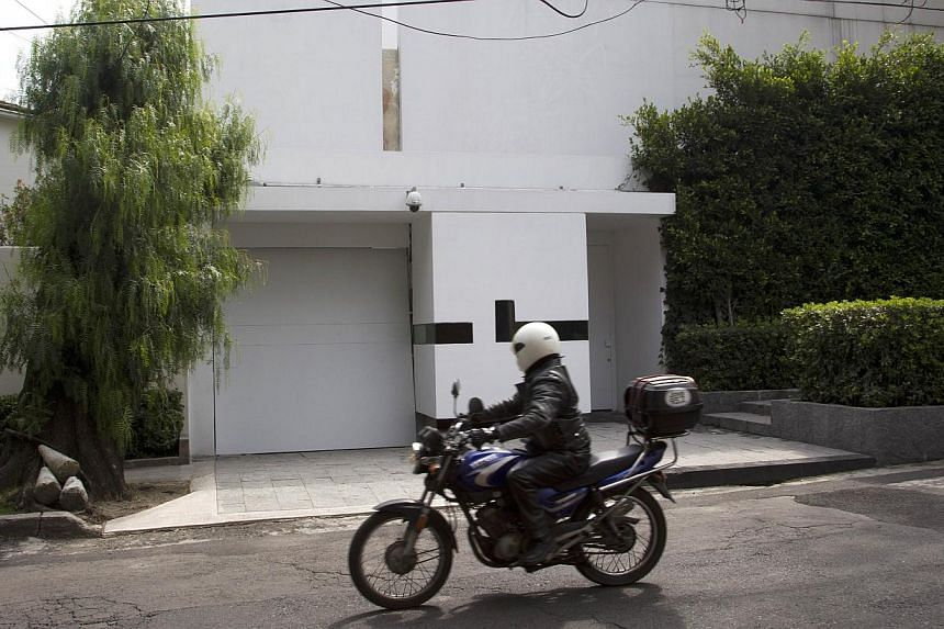 Mexico's First Lady Angelica Riveraannounced late on Tuesday that she was putting her multimillion-dollar private mansion (above, in background) on sale to end a controversy over her purchase of the property from a government contractor. -- PHO