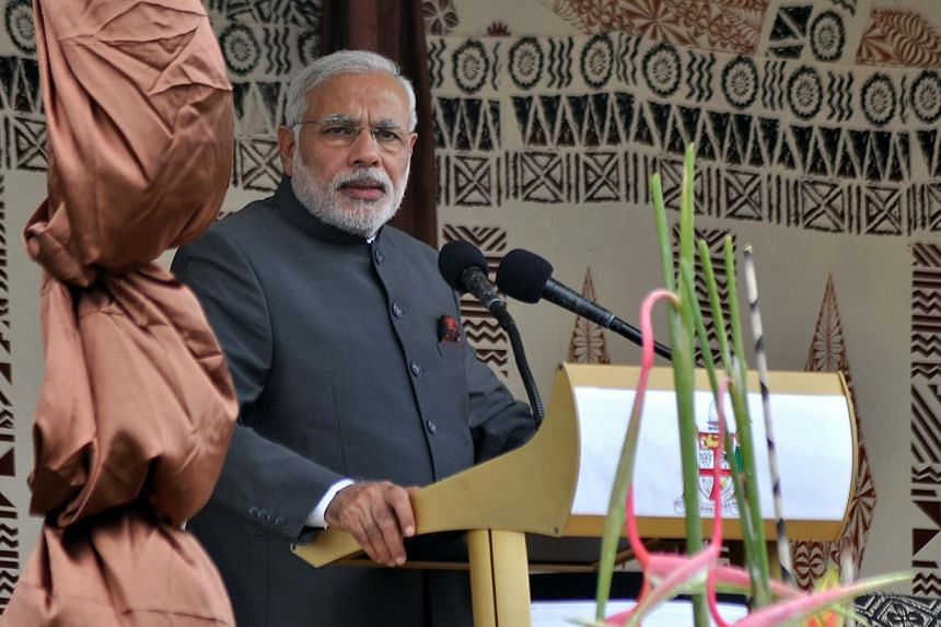 India's Prime Minister Narendra Modi speaks following a traditional welcoming ceremony at Albert Park in Suva on Nov 19, 2014. Mr Modi on Wednesday pledged a multimillion dollar line of credit for Fiji's struggling sugar industry, once worked by thou