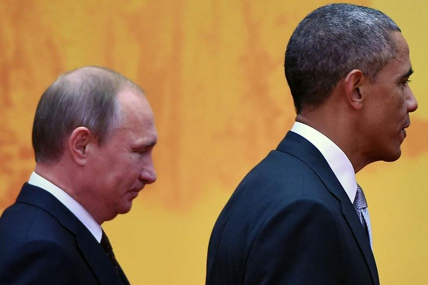 US President Barack Obama (right) with Russian President Vladimir Putin at the Asia-Pacific Economic Cooperation (Apec) summit at Yanqi Lake, north of Beijing, on Nov 11, 2014. Mr Putin said Russia is ready to cooperate with the US, provided it is ba