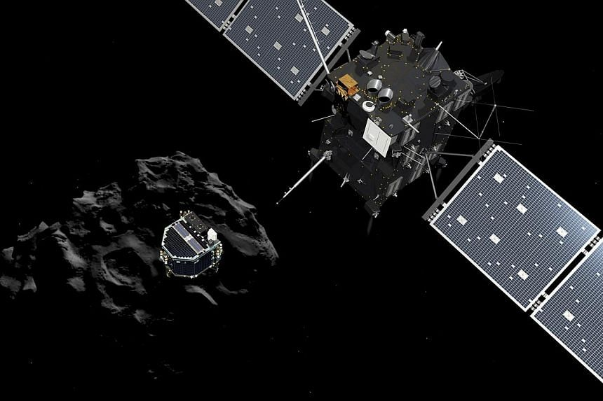 A handout artist's impression showing lander Philae separating from the Rosetta spacecraft and descending to the surface of comet 67P/Churyumov-Gerasimenko.Mankind's first-ever probe of a comet found traces of organic molecules and a surface mu