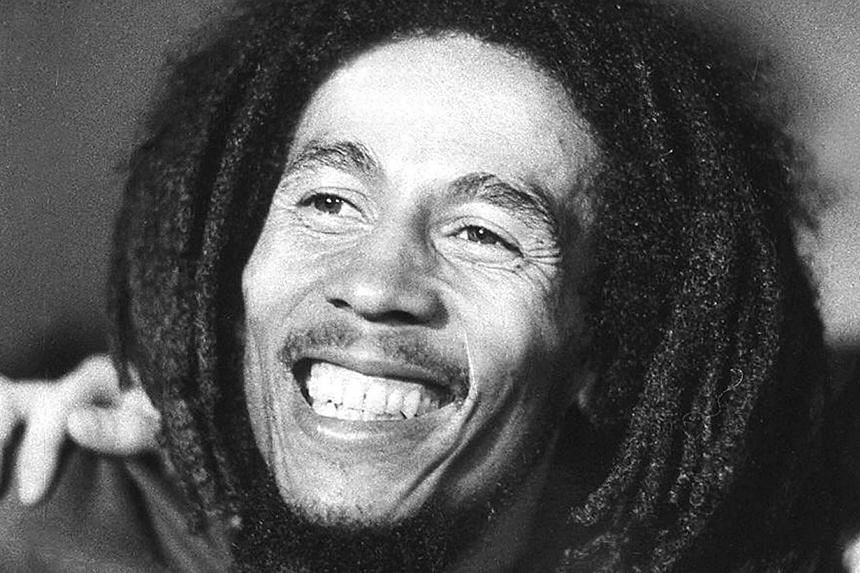 Jamaican reggae star Bob Marley in 1976, three years before his legendary shows at New York's Apollo Theatre, and seven years before his death in 1981 at the age of 36 at Cedars Sinai hospital in Miami from cancer. -- PHOTO: AFP