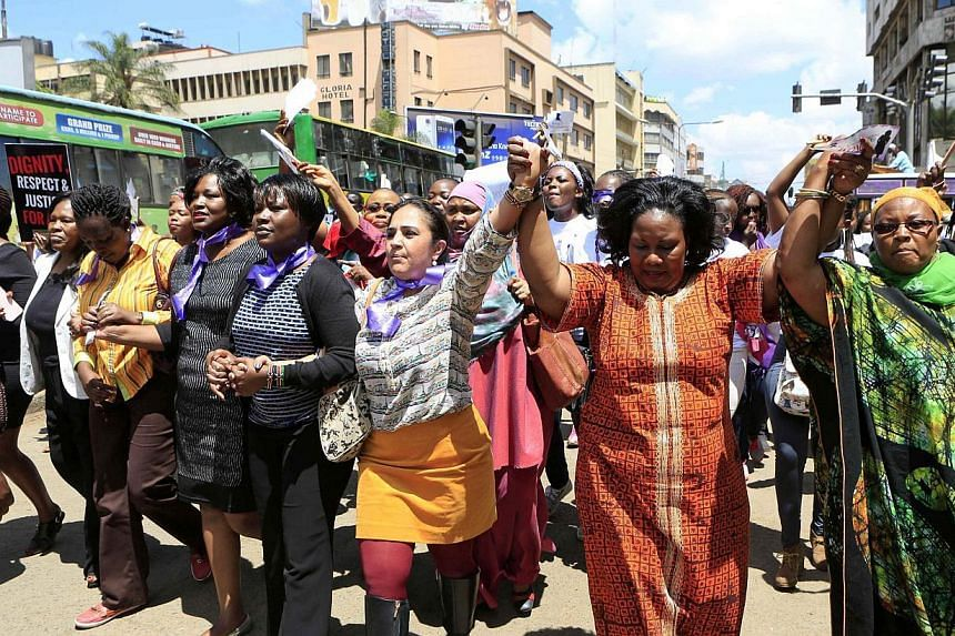Women take part in a protest along a main street in the Kenyan capital of Nairobi Nov 17, 2014. The demonstrators were demanding justice for a woman who was attacked and stripped recently in Nairobi by men who claimed that she was dressed indecently.