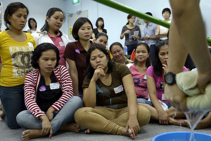 Access to foreign domestic workers has freed up skilled female (and sometimes male) workers to participate in the formal Singaporean economy, while relying on migrants for their household needs. -- ST PHOTO: DESMOND LIM