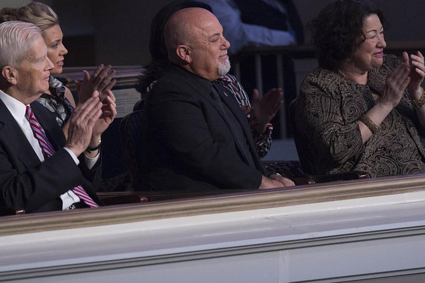Singer Billy Joel, recipient of the 2014 Library of Congress Gershwin Prize for Popular Song, attends a tribute concert in his honour alongside US Supreme Court Justice Sonia Sotomayor (right) and James Billington (left), Librarian of Congress, at DA