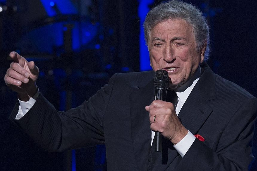 Singer Tony Bennett performs during a tribute concert in honour of singer Billy Joel, recipient of the 2014 Library of Congress Gershwin Prize for Popular Song, at DAR Constitution Hall in Washington, DC on Nov 19, 2014. -- PHOTO: AFP