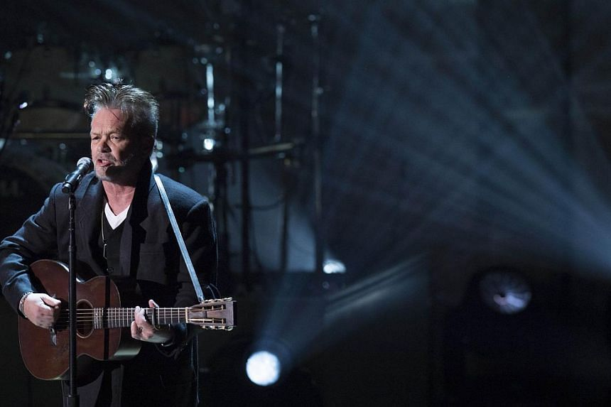 Singer John Mellencamp performs during a tribute concert in honour of singer Billy Joel, recipient of the 2014 Library of Congress Gershwin Prize for Popular Song, at DAR Constitution Hall in Washington, DC on Nov 19, 2014. -- PHOTO: AFP