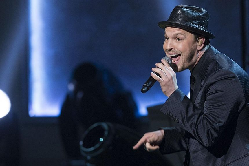 Singer Gavin DeGraw performs during a tribute concert in honour of singer Billy Joel, recipient of the 2014 Library of Congress Gershwin Prize for Popular Song, at DAR Constitution Hall in Washington, DC on Nov 19, 2014. -- PHOTO: AFP