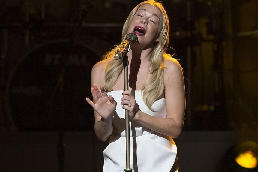 Singer LeAnn Rimes performs during a tribute concert in honour of singer Billy Joel, recipient of the 2014 Library of Congress Gershwin Prize for Popular Song, at DAR Constitution Hall in Washington, DC on Nov 19, 2014. -- PHOTO: AFP