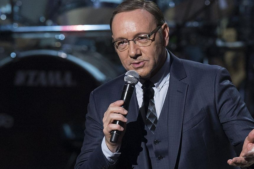 Actor Kevin Spacey speaks during a tribute concert in honour of singer Billy Joel, recipient of the 2014 Library of Congress Gershwin Prize for Popular Song, at DAR Constitution Hall in Washington, DC on Nov 19, 2014. -- PHOTO: AFP