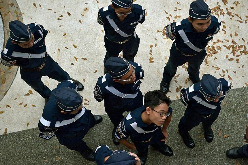 Members of the Boys' Brigade. Its Share-a-Gift project is looking to increase donations for disadvantaged individuals this holiday season by reaching out to Singaporeans who are overseas. -- ST PHOTO: KUA CHEE SIONG