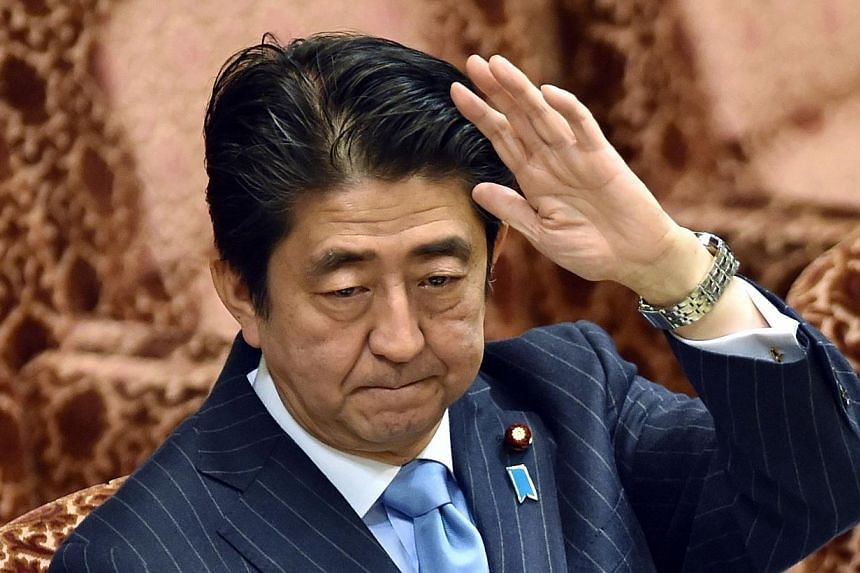 Japan's Prime Minister Shinzo Abe raises his hand to answer questions during an Upper House special committee session at the parliament in Tokyo on Nov 19, 2014.Nearly two-thirds of Japanese voters don't understand why Prime Minister Shinzo Abe