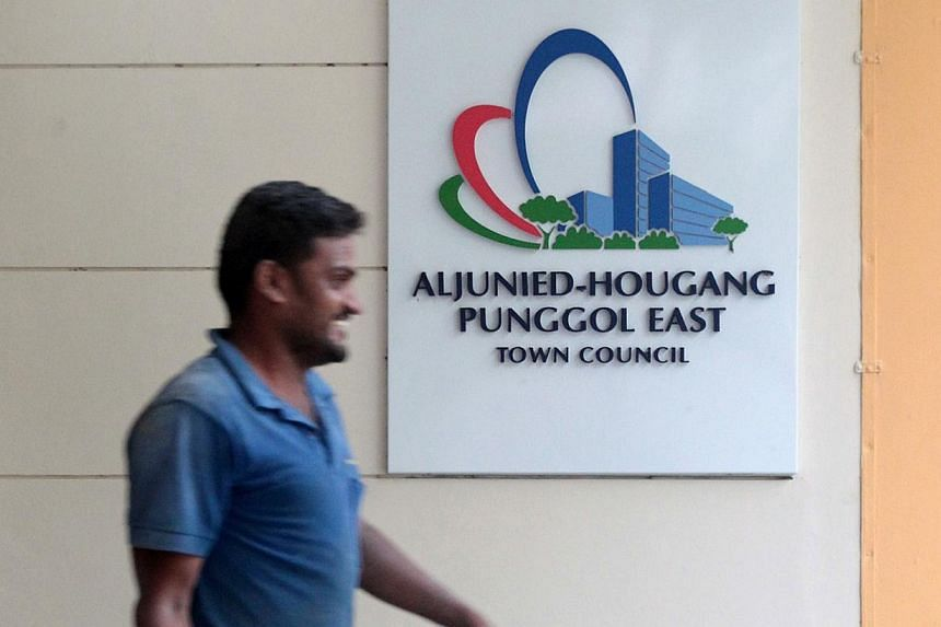 A man walks past the Aljunied-Hougang-Punggol East town council at Rivervale Crescent in Sengkang on April 17, 2014. The Ministry of National Development (MND) has explained how the Government disburses grants to town councils, and how much of a