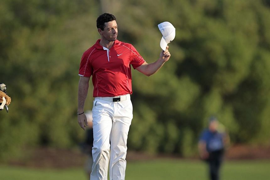 Rory McIlroy of Northern Ireland waves on the 18th green during the first round of the DP World Tour Championship in Dubai on Nov 20, 2014.Rory McIlroy rattled in six birdies in an opening round six-under 66 at the DP World Tour Championship on