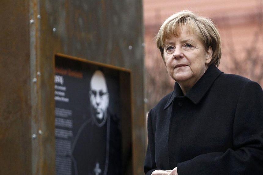 German Chancellor Angela Merkel views an exhibition during an official ceremony in the village of Krzyzowa on Nov 20, 2014. Russia is key to ensuring European security, German Chancellor Angela Merkel said Thursday as she marked a quarter centur