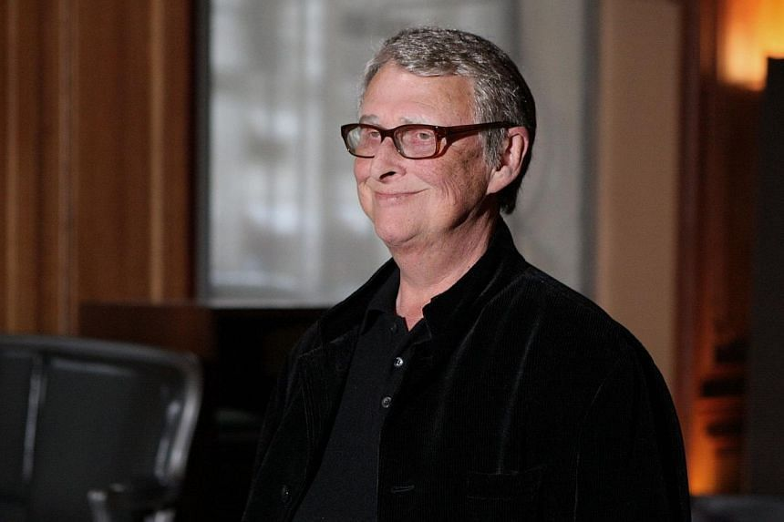 German-born US film director Mike Nichols poses in Paris, during a photocall for his movie Charlie Wilson's War in France on Jan 11, 2008. -- PHOTO: AFP