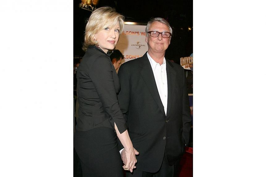 Director Mike Nichols and his wife Diane Sawyer as they arrive at the premiere of Charlie Wilson's War, in Universal Studio, Los Angeles, California onDec 10, 2007. -- PHOTO: AFP