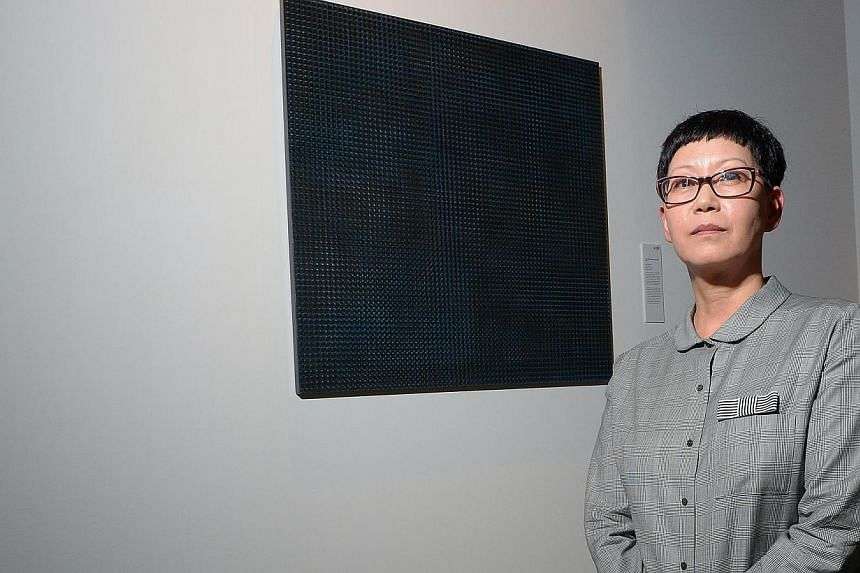 N-PIN56, an oil-on-canvas painting of a starry night sky by local artist Om Mee Al, won the UOB Painting of the Year (Singapore) in the established artist category. -- ST PHOTO: DESMOND WEE