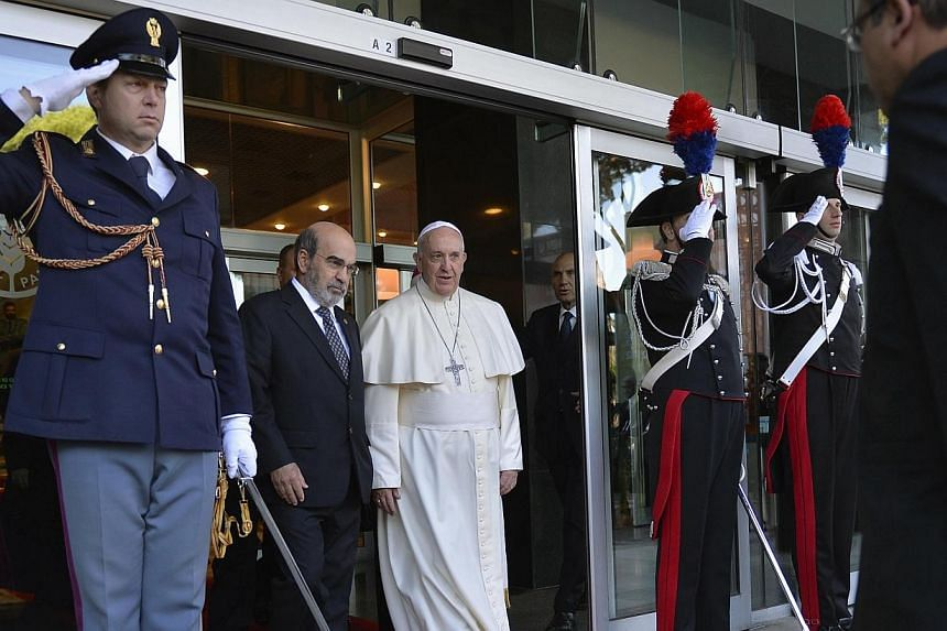 Pope Francis walks with UN Food and Agriculture Organization (FAO) Director-General Jose Graziano da Silva as he leaves at the end of a meeting at the FAO headquarters in Rome on Nov 20, 2014.Pope Francis condemned speculation in food commoditi