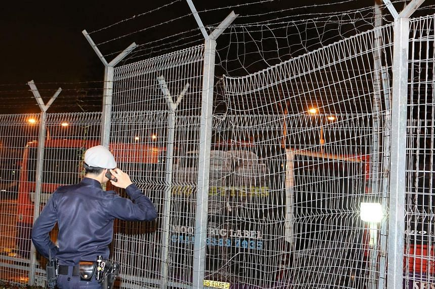 A fence next to SMRT's Ang Mo Kio bus depot was found cut on Nov 13, 2014, night.The damage on a fence found last week at an Ang Mo Kio bus depot was caused by a motor accident, police have said. -- ZAOBAO PHOTO