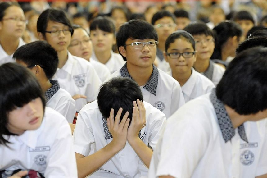 St Hilda's Primary School pupils waiting for their Primary School Leaving Examination (PSLE) results to be announced on Nov 24, 2011. -- PHOTO: ST FILE