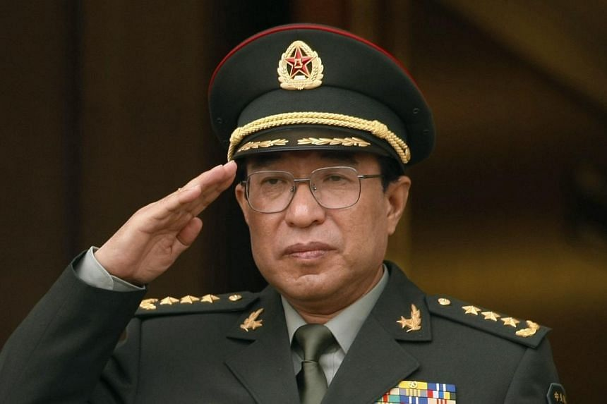 China's then-Central Military Commission Vice Chairman General Xu Caihou salutes as he listens to national anthems during a welcome ceremony at the Pentagon in Washington on Oct 27, 2009.-- PHOTO: REUTERS