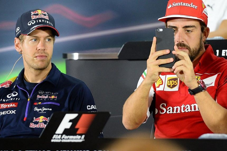 Ferrari confirmed on Thursday that four times world champion Sebastian Vettel (left) would replace Fernando Alonso next season on a three-year deal. -- PHOTO: AFP