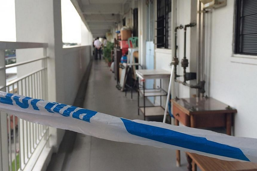 A police cordon near the HDB flat in Ang Mo Kio where a dead woman was found on Thursday. -- PHOTO: HOE PEI SHAN
