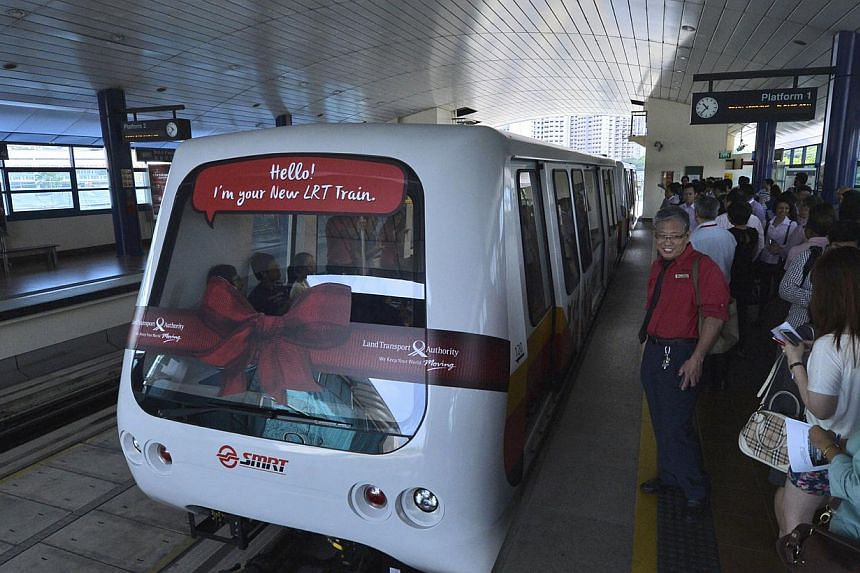 The Bukit Panjang LRT system's new train cars have more handrails and strap-hangers, as well as an air-con system that provides better air flow in the cabin and solar windshields to keep commuters cool.