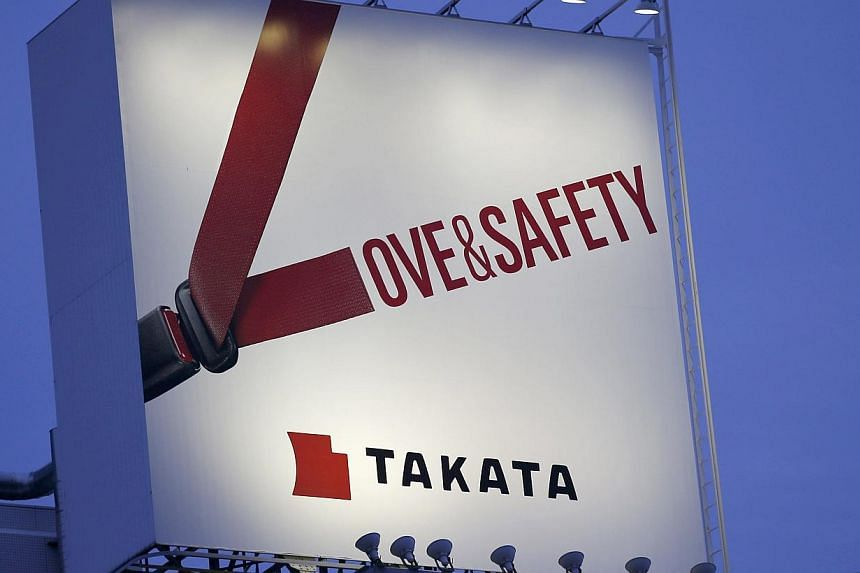 A Takata billboard advertisement is pictured in Tokyo on Sept 17, 2014. Shards from a ruptured Takata-made airbag killed the driver of a Honda Accord after a traffic accident in Florida, according to the final autopsy report, the first official confi