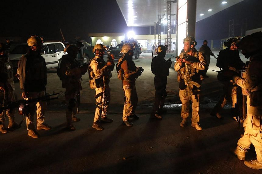 Afghan security forces arrive at the site of a Taliban assault in Kabul Nov 19, 2014. Four Afghan Taliban suicide bombers died when a group of the militants tried to storm an international zone in Kabul on Wednesday in the latest high-profile assault