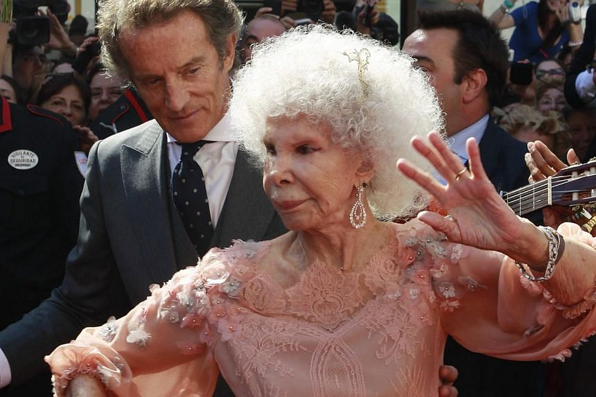 Spain's Duchess of Alba Maria del Rosario Cayetana Fritz-James Stuart doing the flamenco beside her husband Alfonso Diez outside Las Duenas Palace after their wedding in Seville in this Oct 5, 2011, photo. -- PHOTO: REUTERS