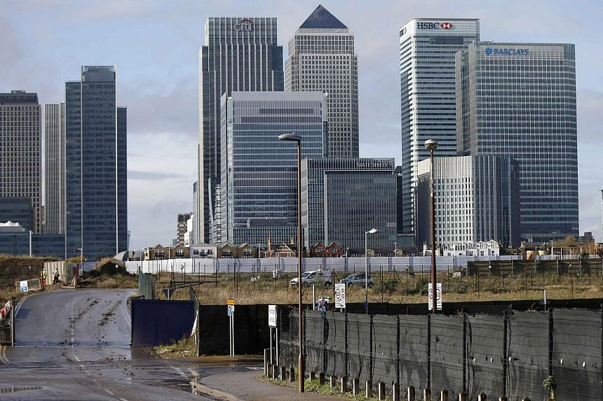 The Canary Wharf financial district in east London. Britain's Financial Conduct Authority said on Nov 12, 2014, it has imposed fines totalling US$1.7 billion (S$2.2 billion) on five banks for failing to control business practices in their G10 spot fo