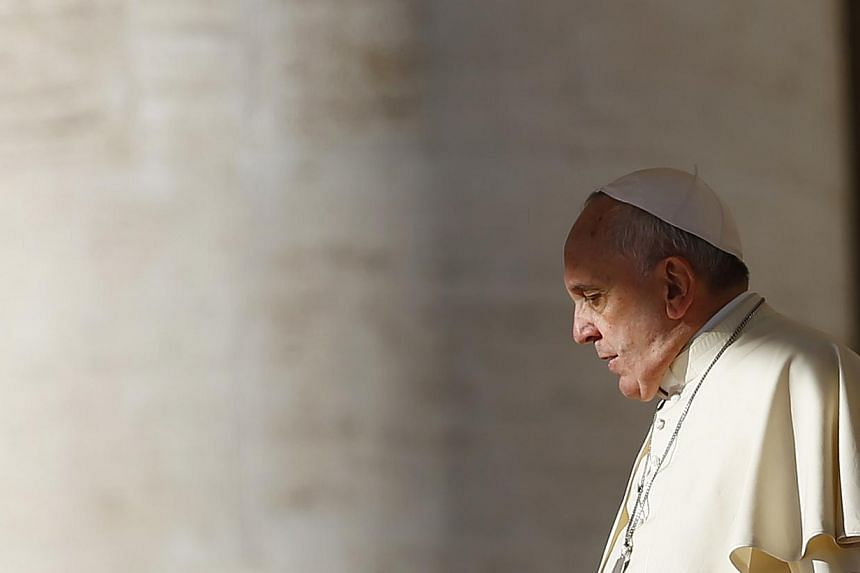 Pope Francis arrives to lead his Wednesday general audience in Saint Peter's square at the Vatican Nov 19, 2014. Turkish extremist Mehmet Ali Agca, who attempted to assassinate Pope John Paul II more than three decades ago, has asked the Vatican for