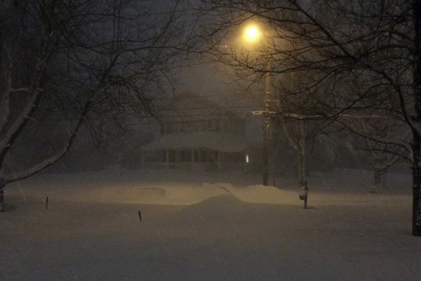 Heavy Lake Effect snow falls in Orchard Park, New York, on Nov 18, 2014. -- PHOTO: REUTERS